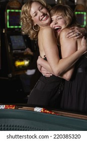 Women hugging at a casino