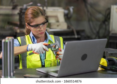 A women inspecting,checking steel part product quality in the factory concept of product quality control