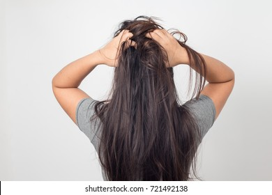 Women itching scalp damaged hair, Haircare concept.