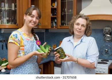 Women with jar in the kitchen