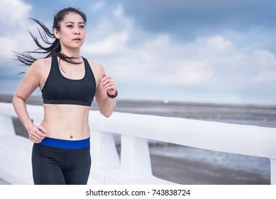 Women jogging outdoors on the bridge
