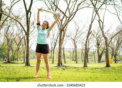 Women are jogging in the park and woman listening to music on running Belt.