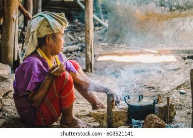 Women Karen cooking breakfast.on March 9,2017 in Chiang mai, Thailand.Karen is ethnic group in Thailand.