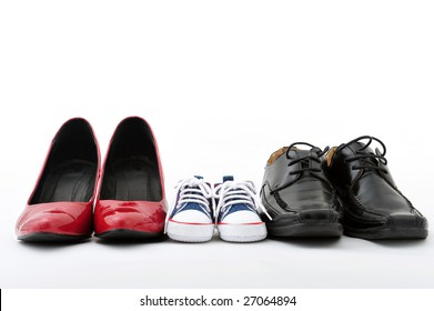 Women, kid, and men shoes on white background, family concept