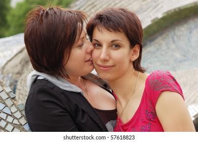 women kiss outdoor