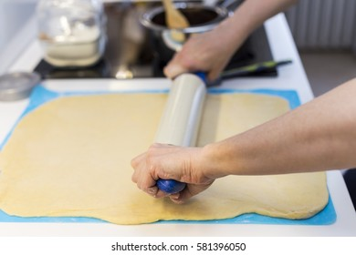 Women in the kitchen provides a dough.