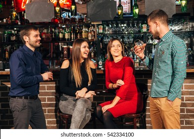 women laugh at the jokes  the bar
