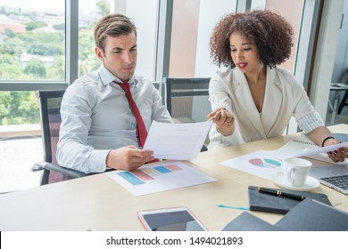 Women lawyers are talking to a lawyer colleagues met to consider the documents in law firm office