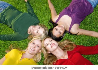 Women laying in grass