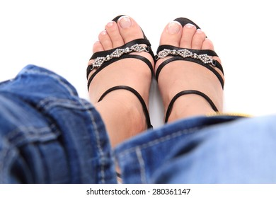 women legs in the black shoes isolated on the white background