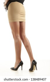 women legs with black shoes on white background