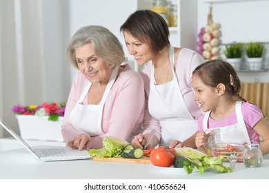 women with little girl cooking