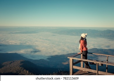 Women lonely is stay to see the mist and location  on terrace wood