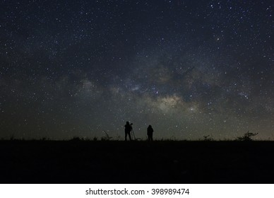 Women look into space and the Milky way. Long exposure photograph
