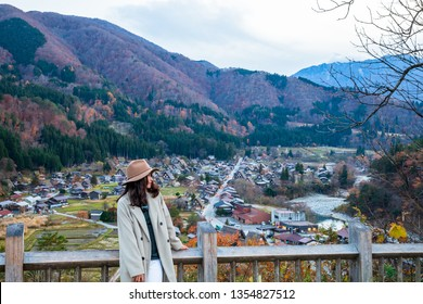 Women look at View from the hill See the Shirakawago in the autumn .It is a village with beautiful scenery reminiscent of the old days. The village has a Gassho-style house.Gifu,Japan
