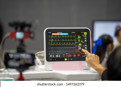 Women looking at Heart rate monitor