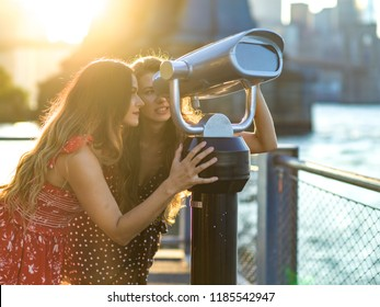 Women looking into binocular