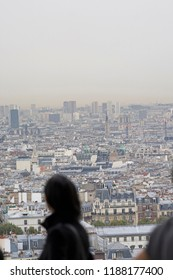 Women looking out over city of Paris