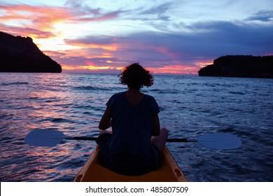 Women looking sunset on kayaking between the Islands at angthong National park.