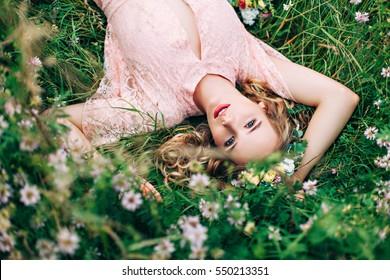 Women Lying On Green Grass