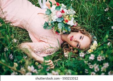 Women Lying On Green Meadow