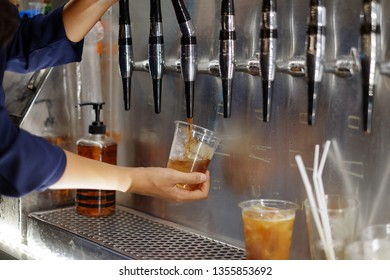 women made nitro cold brew coffee - Shutterstock ID 1355853692