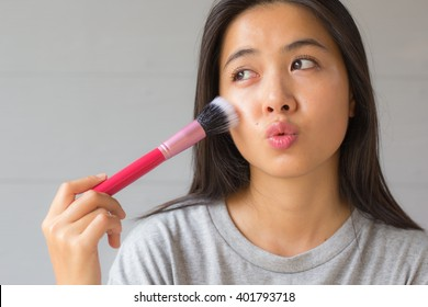 Women with make-up brushes