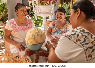 Women making Tortillas Group of smiling cooks preparing flat bread tortillas in Yucatan, Mexico