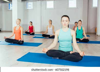 women making yoga meditation in lotus pose .fitness, sport, people and healthy lifestyle concept