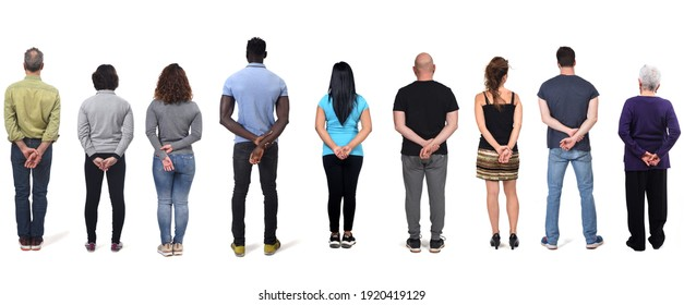 women and man with hands crossed behind back on white background