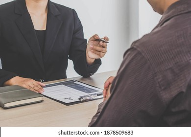 Women manager interviewing job applicants, She is inquiring about applicants' information and checking their resume, job interview ideas.