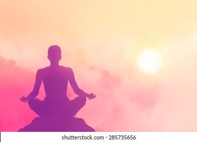 women meditating pastel on high mountain in sunset background