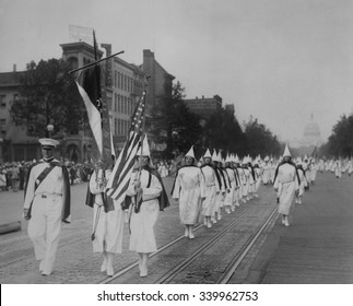 Women members lead a 1928 Ku Klux Klan parade on Pennsylvania Avenue. After D. W. Griffith's film 'Birth of A Nation', portrayed Klansmen as heroes, the KKK was revived and grew to an estimated member - Shutterstock ID 339962753