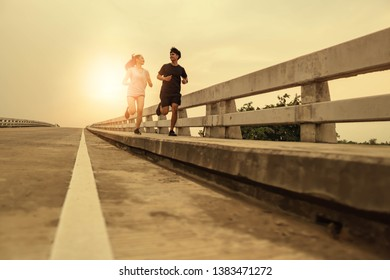 Women and men jogging in the evening for good health.