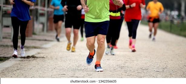 Women and men run at cross country race