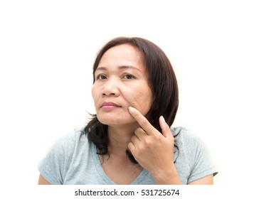 women middle aged worried  with aging face.