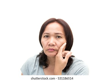 women middle aged worried and emotional with aging face with a sad expression.