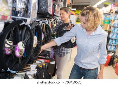 Women in motoring accessories shop
