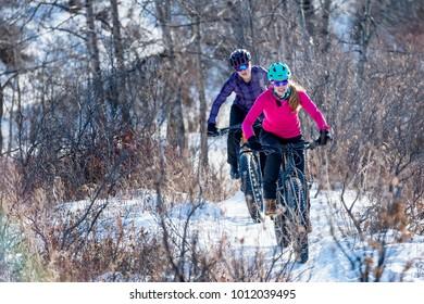 Women Mountain Biking on Fat Bikes in the winter