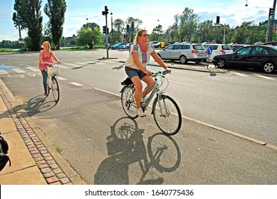 Women moving with bicycles in the streets of Copenhagen, Denmark, July  19 2011.