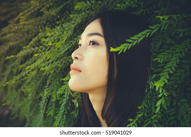 Women with nature.Close-up face.Feeling in the eyes.