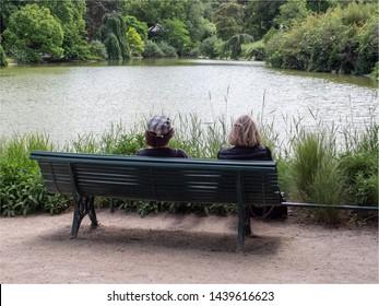 women on a bench at the Montsouris park at Paris