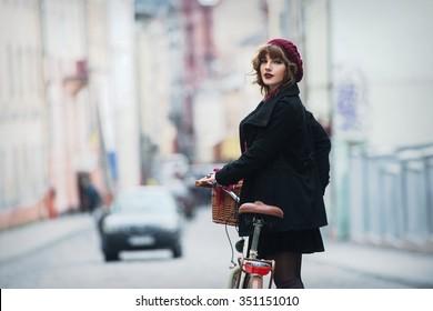 women on the  bike, retro, skirt, street. Girl on bike
