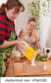 Women on kitchen do the fresh dough.
