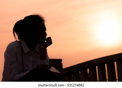 Women on sad concept in the sunset