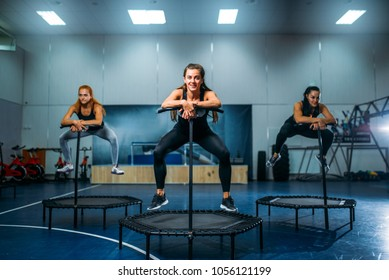 Women on trampoline in motion, fitness training