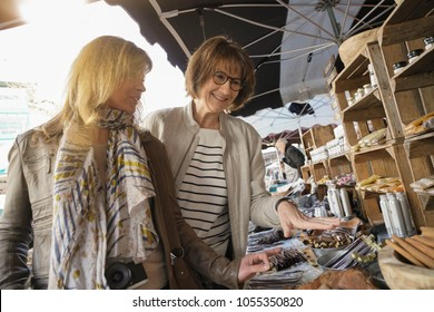 Women on vacation walking in outdoor market