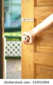Women opens  the door.