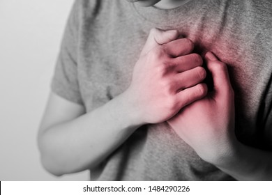 Women with pain at the heart. Young women with heart disease. Women have symptoms of heart attack, congestive heart failure.