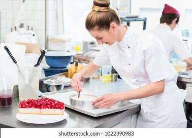 Women in pastry shop bakery making pies and cakes ready